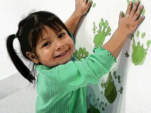 Child Finger Painting Wall