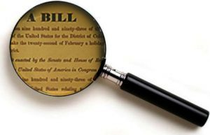 legislative bill with magnifying glass