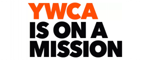 "Banner that says ""YWCA is on a mission"" in all caps in orange and black lettering"